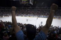 A fan celebrates an Admirals win