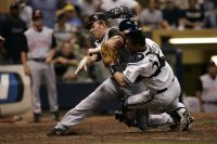 Adam Dunn collides with Milwaukee Brewers catcher Damian Miller