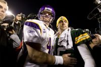 Brett Favre and Aaron Rodgers meet on the field following the game
