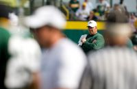 Mike McCarthy keeps an eye on training camp workouts